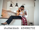 shot of young couple embracing... | Shutterstock . vector #654082732