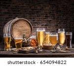 glasses of beer and ale barrel... | Shutterstock . vector #654094822
