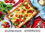 deliciously simple tomato tart... | Shutterstock . vector #654096502