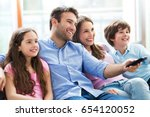 family watching tv  | Shutterstock . vector #654120052