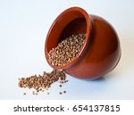 clay pot with dry buckwheat on... | Shutterstock . vector #654137815