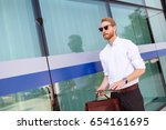 businessman using tablet... | Shutterstock . vector #654161695