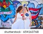 two brides white dresses... | Shutterstock . vector #654163768