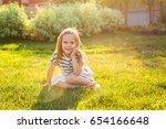 cute little girl is playing in... | Shutterstock . vector #654166648