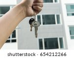 a hand is holding a key from... | Shutterstock . vector #654212266