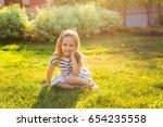 sweet little girl play outdoors | Shutterstock . vector #654235558