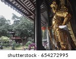 golden guardian statue at... | Shutterstock . vector #654272995