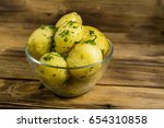 boiled new potatoes with butter ... | Shutterstock . vector #654310858