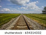 Railroad Track In Open Green...
