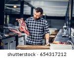 portrait of a bearded meat man... | Shutterstock . vector #654317212