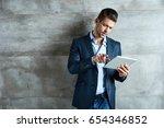 confident serious businessman... | Shutterstock . vector #654346852
