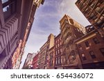 narrow alley with old apartment ... | Shutterstock . vector #654436072