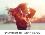 cheerful happy young adult girl ... | Shutterstock . vector #654442702