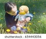 little girl playing with hand... | Shutterstock . vector #654443056