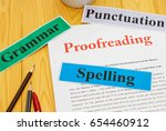 proofreading paper on table... | Shutterstock . vector #654460912