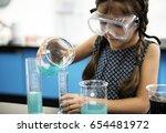 kindergarten student mixing... | Shutterstock . vector #654481972