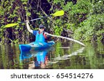 man paddling in a kayak on ... | Shutterstock . vector #654514276