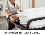 cropped image of a young hotel... | Shutterstock . vector #654521452