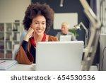 mixed race businesswoman... | Shutterstock . vector #654530536
