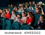 young girls enjoying watching a ... | Shutterstock . vector #654532312