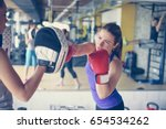 woman boxer hitting the glove... | Shutterstock . vector #654534262