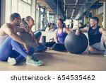 group of people workout in... | Shutterstock . vector #654535462