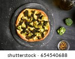 pizza with broccoli on dark... | Shutterstock . vector #654540688