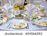 dining table setting at... | Shutterstock . vector #654566392