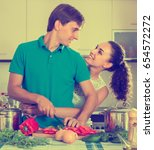 young husband helping wife to... | Shutterstock . vector #654572272