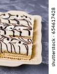 pieces of biscuit cake with...   Shutterstock . vector #654617428