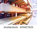 blurred wooden bars from floor... | Shutterstock . vector #654627622