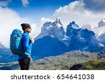 traveler with backpack hiking... | Shutterstock . vector #654641038