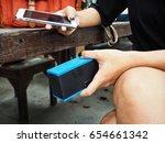 woman using bluetooth speaker... | Shutterstock . vector #654661342