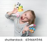 lovely small girl with doll... | Shutterstock . vector #654664546