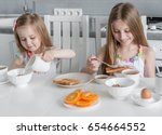 two lovely sisters at the table ... | Shutterstock . vector #654664552