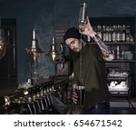 stylish barman in action in a...   Shutterstock . vector #654671542