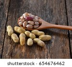 boiled peanuts on wood | Shutterstock . vector #654676462