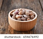 boiled peanuts on wood | Shutterstock . vector #654676492
