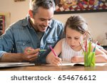a father helps his little... | Shutterstock . vector #654676612