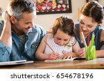 mom and dad help their little... | Shutterstock . vector #654678196