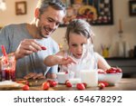 a father and his little girl... | Shutterstock . vector #654678292