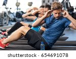 muscular guy doing sit ups at... | Shutterstock . vector #654691078