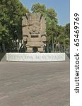 Small photo of Entrance to The National Museum of Anthropology in Mexico City Colossal stone sculpture representing Tlaloc, a very important deity of Aztec culture (God of Rain).