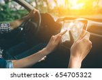 couple using gps on tablet... | Shutterstock . vector #654705322