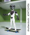 Small photo of Toy alien on skateboard.