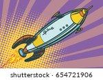 retro space ship flies up. pop... | Shutterstock .eps vector #654721906