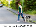 motion blur picture of a woman... | Shutterstock . vector #654723592