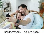 family. father with daughter at ... | Shutterstock . vector #654757552