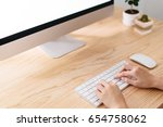 hand of woman using computer on ... | Shutterstock . vector #654758062