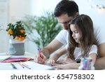 family. father with daughter at ... | Shutterstock . vector #654758302